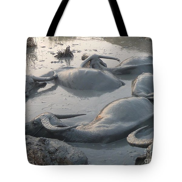Medium Shot Of A Group Of Water Buffalos Wallowing In A Mud Hole Tote Bag by Jason Rosette