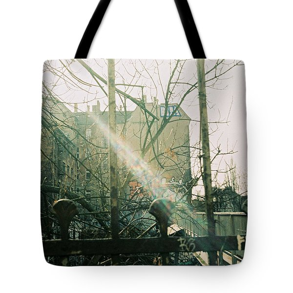 Metal Fence With Grafitti And Bridge Tote Bag