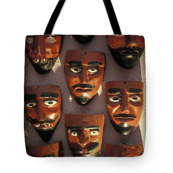 Tote Bag featuring the photograph Mexican Devil Masks by John  Mitchell