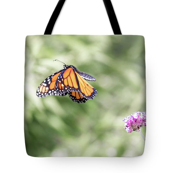 Tote Bag featuring the photograph Mid-air Monarch 1 by Brian Hale