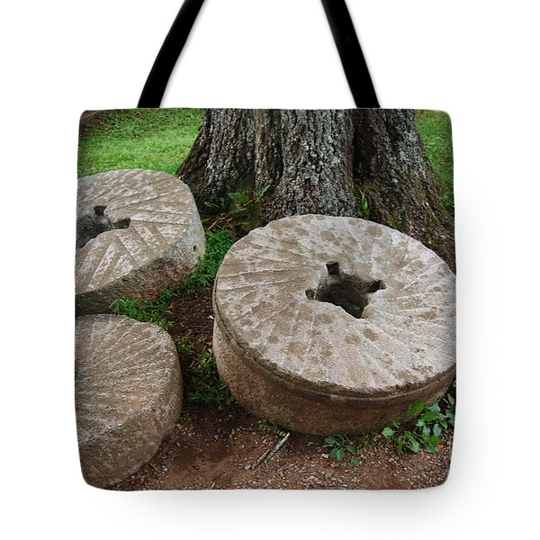 Tote Bag featuring the photograph Mill Stone by Eric Liller