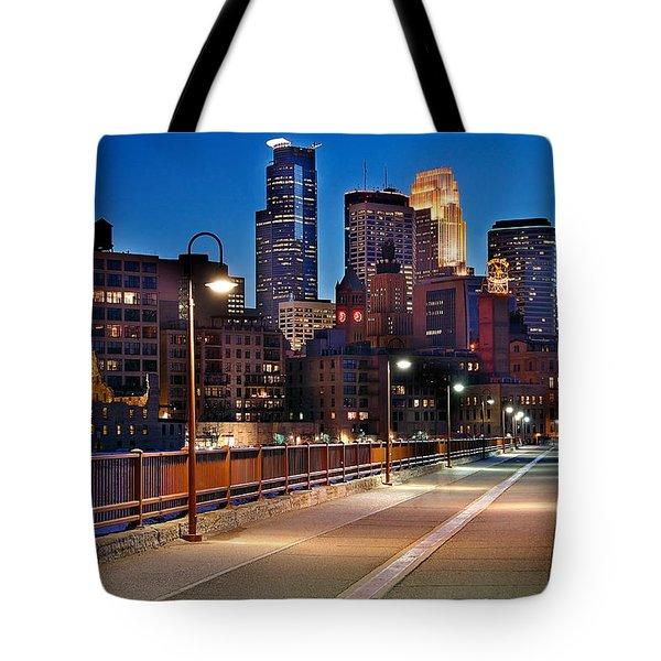 Minneapolis Skyline From Stone Arch Bridge Tote Bag by Jon Holiday