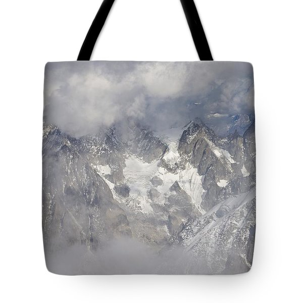 Mist And Clouds At Auiguille Du Midi Tote Bag