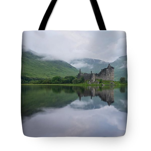 Mist Swarms Around Kilchurn Castle Tote Bag