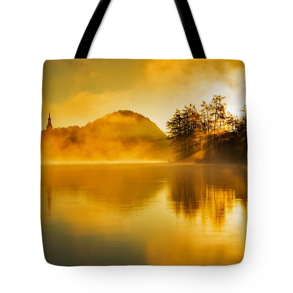 Tote Bag featuring the photograph Misty Sunrise At Lake Bled by Ian Middleton