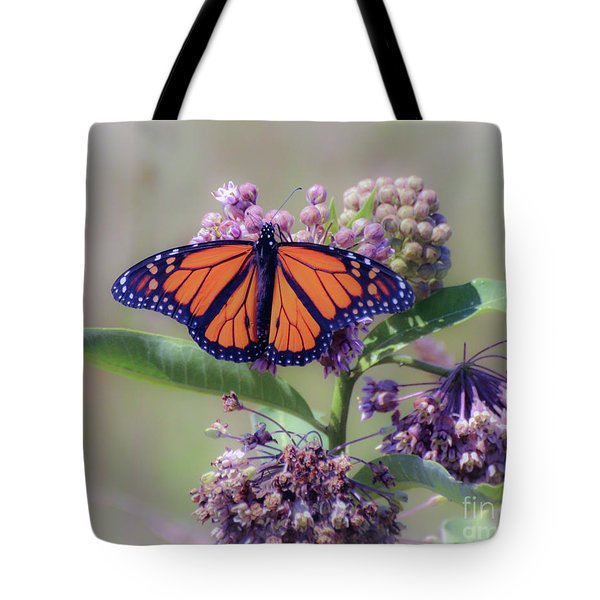 Tote Bag featuring the photograph Monarch On The Milkweed by Kerri Farley