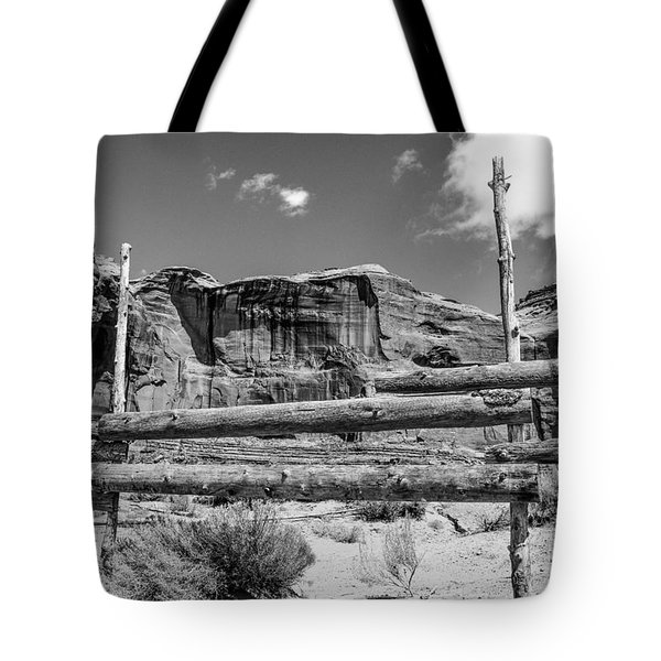 Tote Bag featuring the photograph Fence In Monument Valley - Bw by Dany Lison