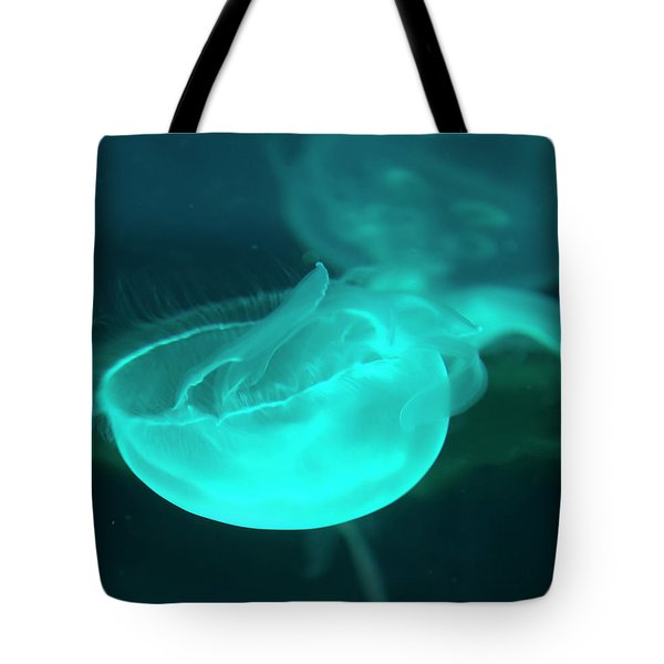 Tote Bag featuring the photograph moon Jellyfish 01 by Chris Flees