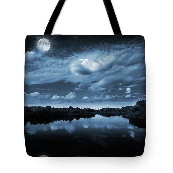 Moonlight Over A Lake Tote Bag by Jaroslaw Grudzinski