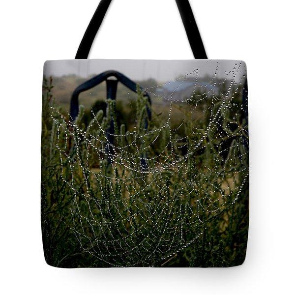 Morning Dew On Spider Webs Tote Bag by Karen Slagle