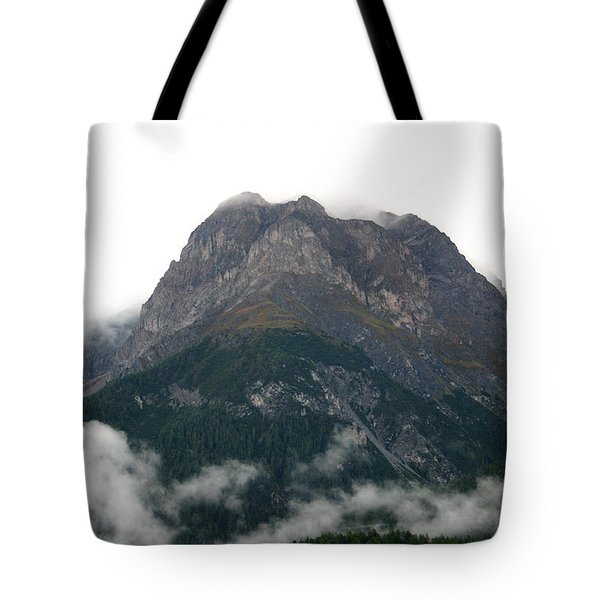 Tote Bag featuring the photograph Mountain Over Clouds by Emanuel Tanjala