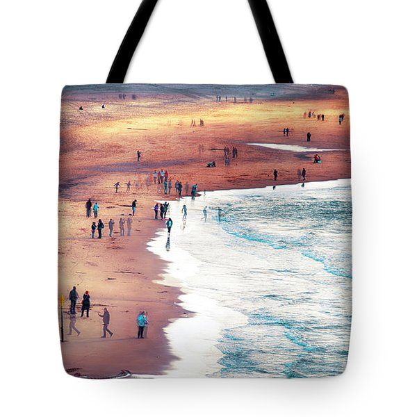 Tote Bag featuring the photograph multiple exposure of people on North sea beach  by Ariadna De Raadt