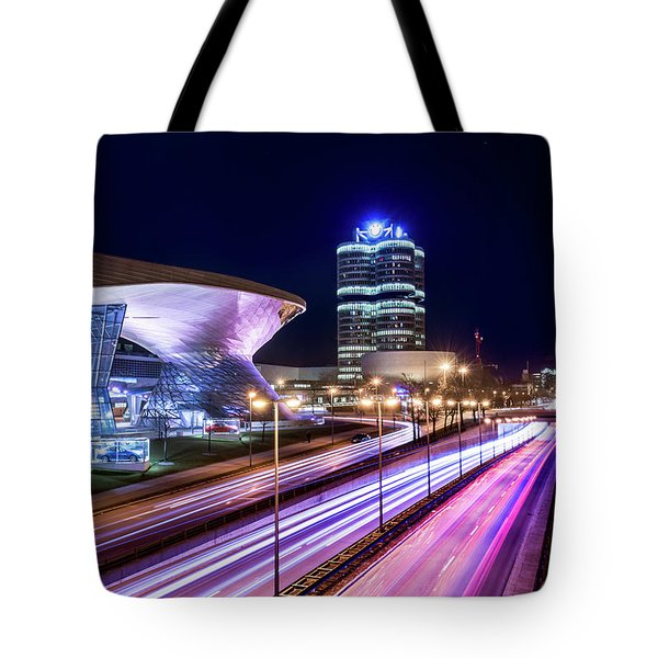 Tote Bag featuring the pyrography Munich - Bmw City At Night by Hannes Cmarits