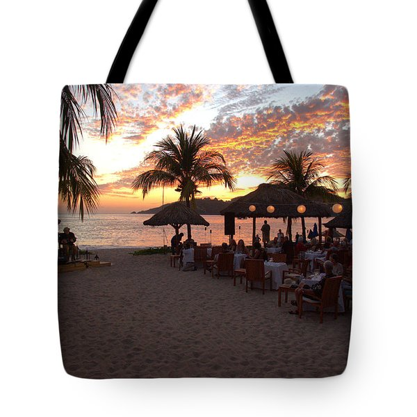 Tote Bag featuring the photograph Music And Dining On The Beach by Jim Walls PhotoArtist