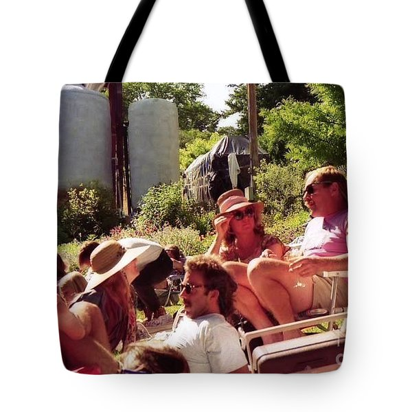 Music Fans Rest On The Grass Tote Bag