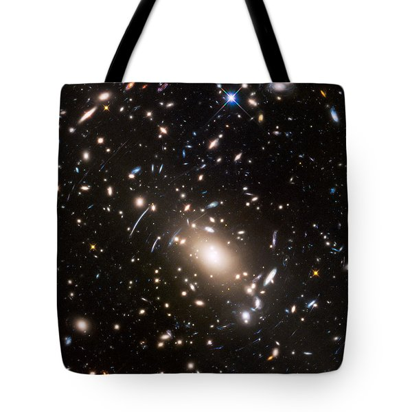 Tote Bag featuring the photograph Nasa's Hubble Looks To The Final Frontier by Nasa