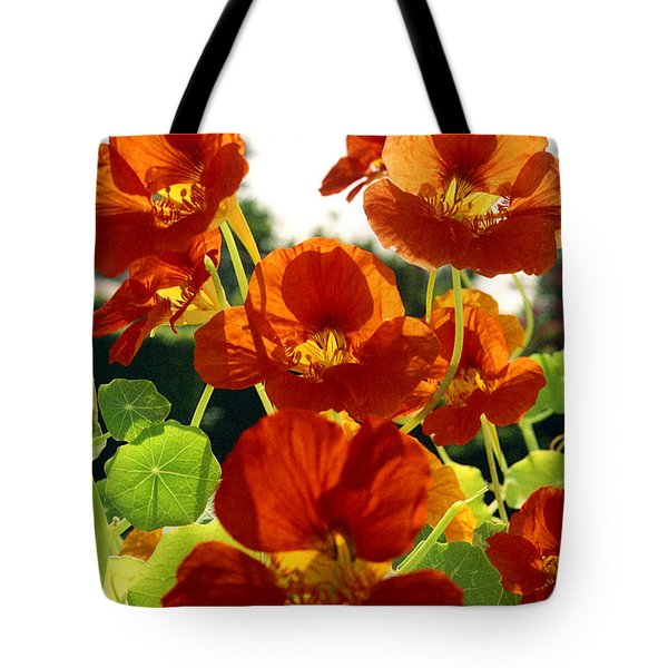Tote Bag featuring the photograph Nasturtiums by Emanuel Tanjala