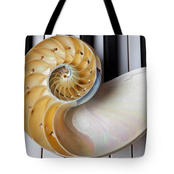 Nautilus Shell On Piano Keys Tote Bag by Garry Gay