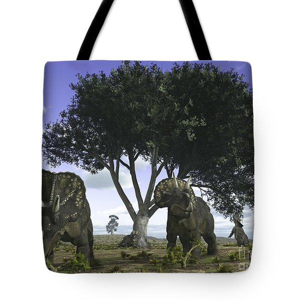 Nedoceratops Graze Beneath A Giant Oak Tote Bag by Walter Myers