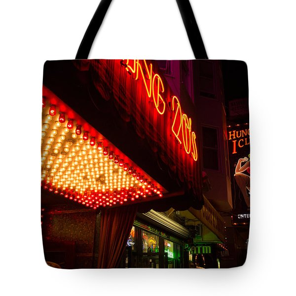 Neon Signs At Night In North Beach San Francisco With Light Bulb Awning Tote Bag by Jason Rosette