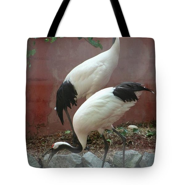 Nesting Cranes Tote Bag by Calvin Nelson