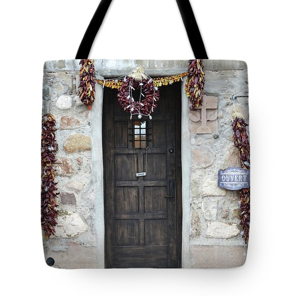 Tote Bag featuring the photograph New Mexico Red Chili Ristras Door by Andrea Hazel Ihlefeld