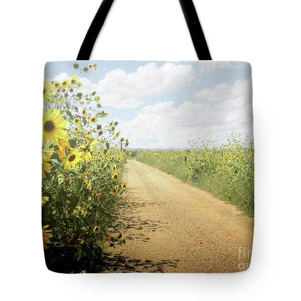 Tote Bag featuring the photograph New Mexico Sunflower Road by Andrea Hazel Ihlefeld