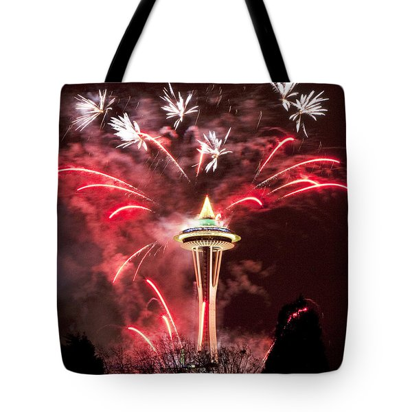 Tote Bag featuring the photograph New Years At The Space Needle by Peter Simmons