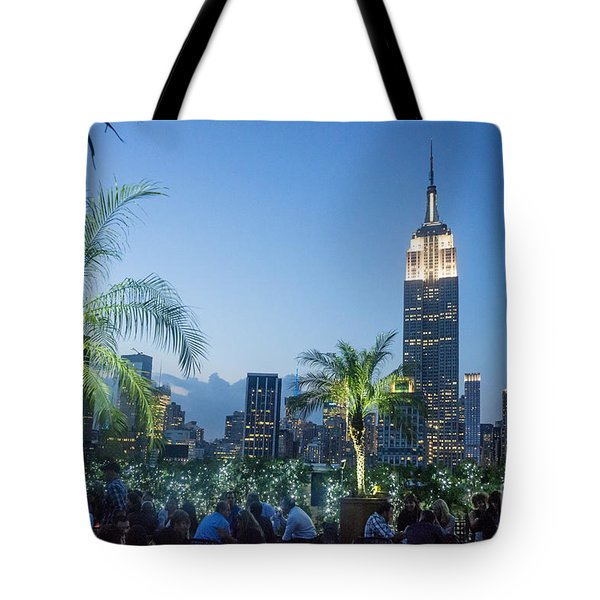 Tote Bag featuring the photograph New York 230 Fith Rooftop Bar  by Juergen Held