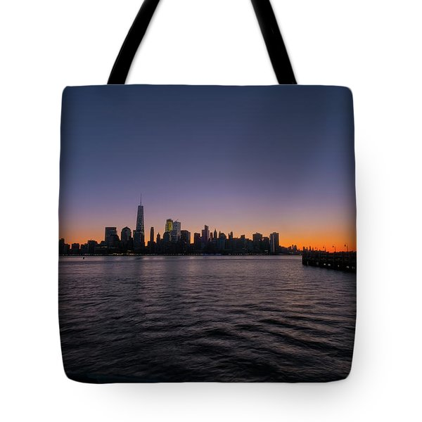 Tote Bag featuring the photograph New York City Sunrise by Tom Singleton