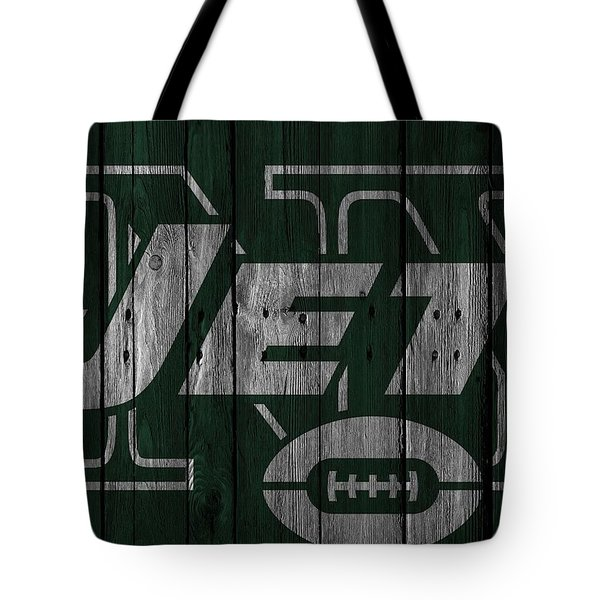 New York Jets Wood Fence Tote Bag by Joe Hamilton