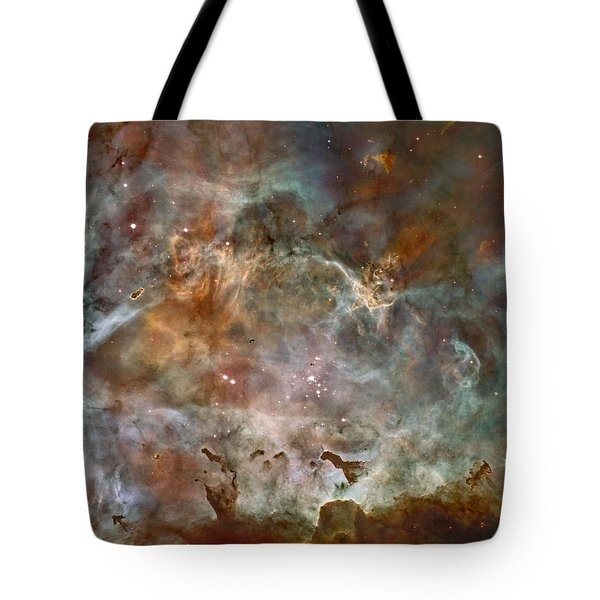 Tote Bag featuring the pyrography Ngc 3372 Taken By Hubble Space Telescope by Artistic Panda