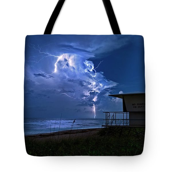 Tote Bag featuring the photograph Night Lightning Under Full Moon Over Hobe Sound Beach, Florida by Justin Kelefas