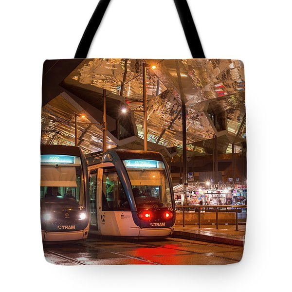 Night View Of Two Trams At Glories Station  Tote Bag