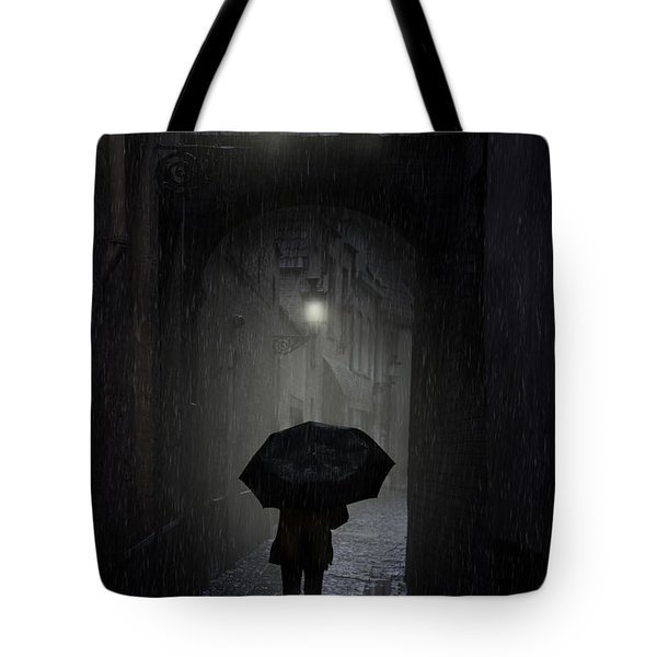 Tote Bag featuring the photograph Night Walk In The Rain by Jaroslaw Blaminsky