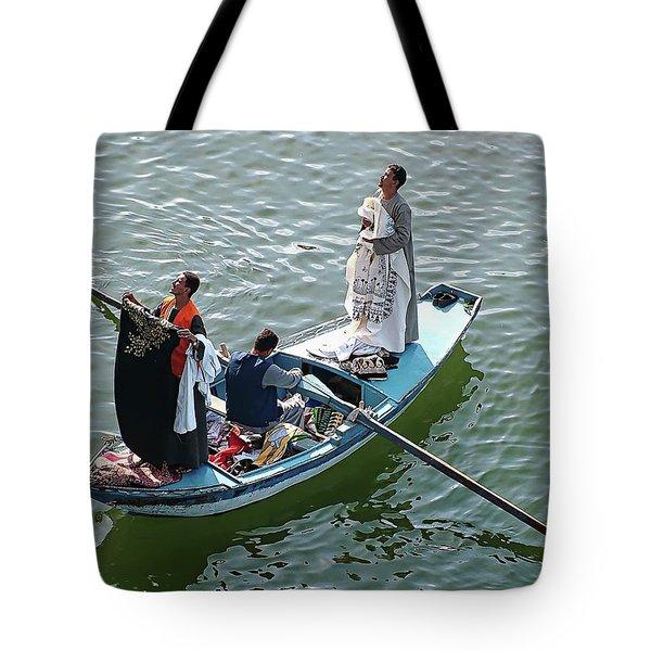 Tote Bag featuring the digital art Nile River Garment Vendors - Egypt by Joseph Hendrix