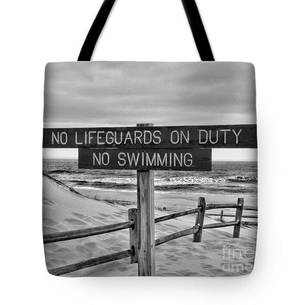 Tote Bag featuring the photograph No Lifeguards On Duty Black And White by Paul Ward