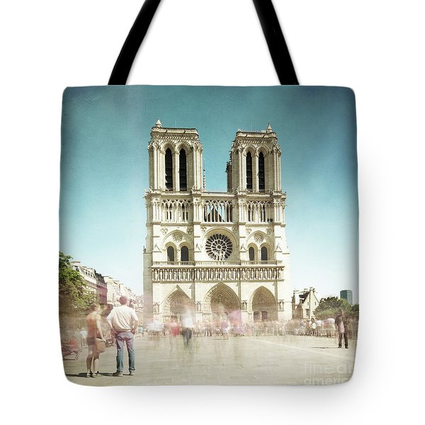Tote Bag featuring the photograph Notre Dame by Hannes Cmarits