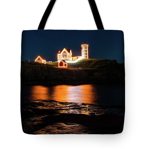 Tote Bag featuring the photograph nubble Lighthouse, York Maine by Jeff Folger
