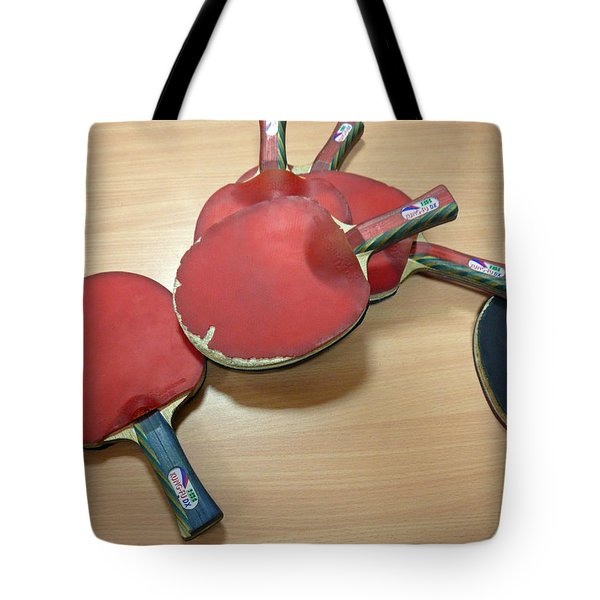Number Of Ping Pong Bats Piled On A Table Tote Bag
