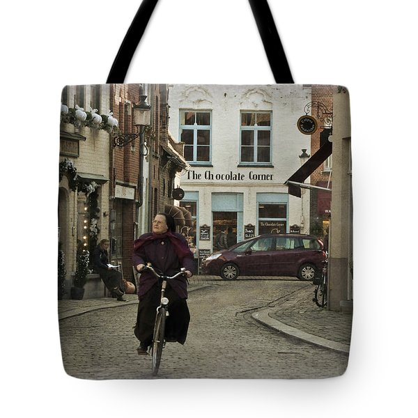 Nun On A Bicycle In Bruges Tote Bag by Joan Carroll