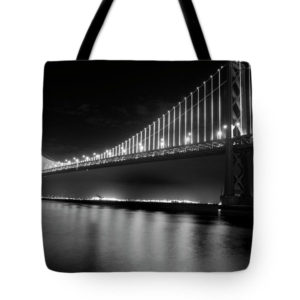 Tote Bag featuring the photograph Oakland Bay Bridge At Night by Darcy Michaelchuk