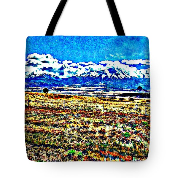 Tote Bag featuring the photograph October Clouds Over Spanish Peaks by Anastasia Savage Ealy