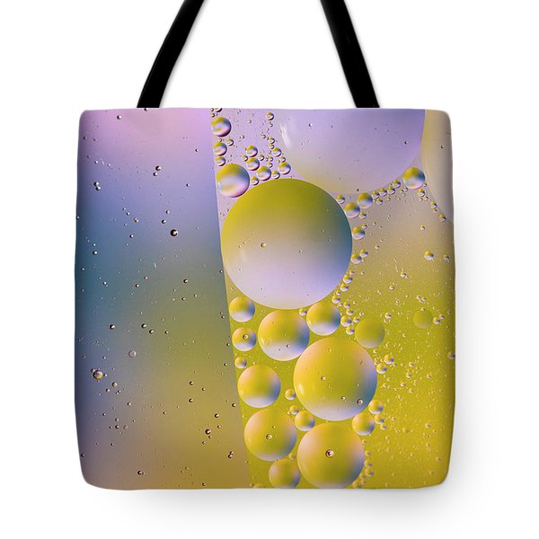 Tote Bag featuring the photograph Oil In Water by Kevin Blackburn