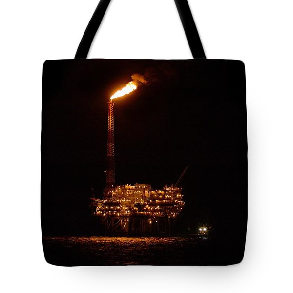Tote Bag featuring the photograph Oil Rig At Night by Bradford Martin