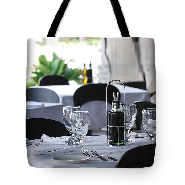 Oils And Glass At Dinner Tote Bag by Rob Hans
