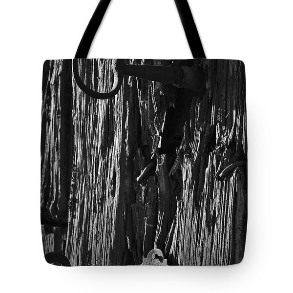 Old And Abandoned Wooden Door With Skeleton Keys Tote Bag