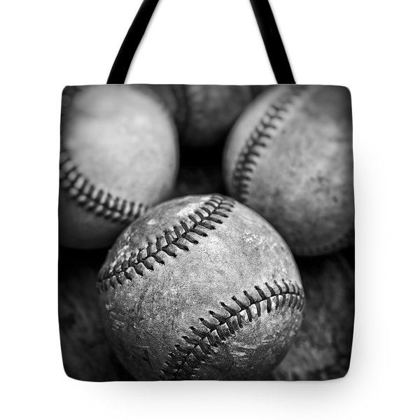 Tote Bag featuring the photograph Old Baseballs In Black And White by Edward Fielding