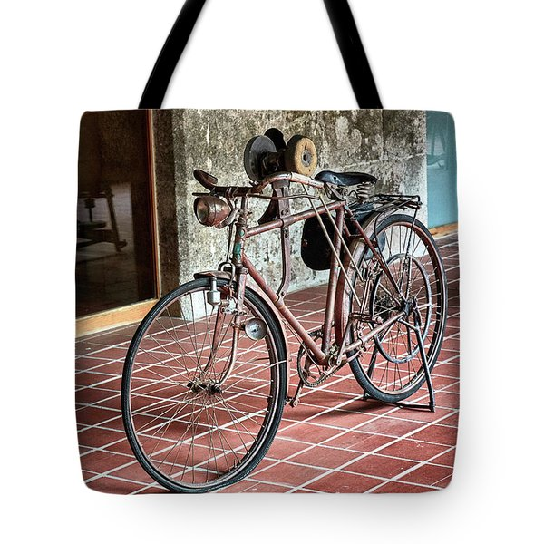 Tote Bag featuring the photograph Old Bicycle In The Monastery Of Santo Estevo De Ribas Del Sil by Eduardo Jose Accorinti