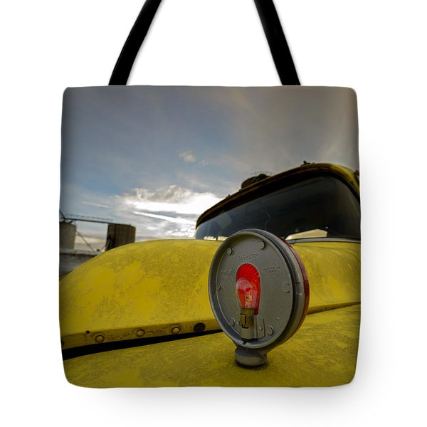 Old Chevy Truck With Grain Elevators In The Background Tote Bag
